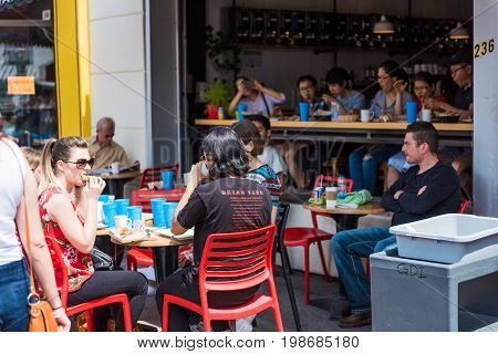 Montreal Canada - May 28 2017: Restaurant outside seating area with people sitting at tables at Jean-Talon farmers market