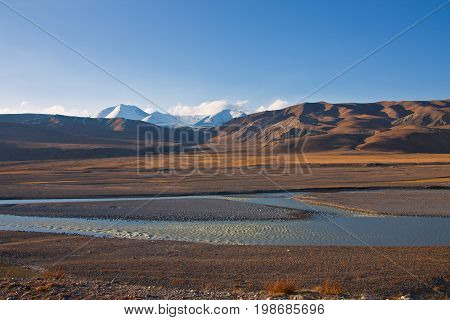 Floodplain of the river and pastures in the Tien Shan. The Issyk-Kul region Kyrgyzstan