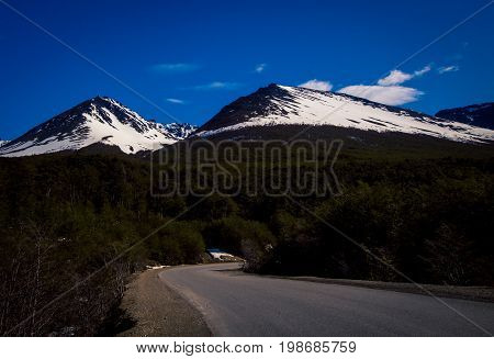 Road to the snow covered mountains in Ushuaia