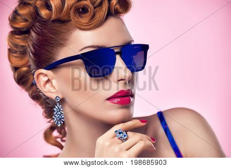 Fashion Portrait Redhead Model Sexy Girl. Stylish Mohawk hairstyle, Fashion Makeup. Glamour Sunglasses, Party Disco Outfit. Beauty Woman in Trendy Luxury Accessories. Playful cheeky fashion girl.