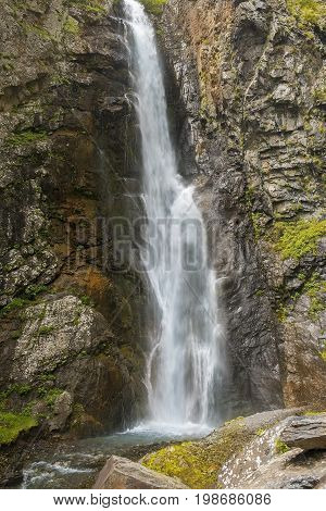 landscape with a waterfall in the Caucasus Mountains, Kazbegi region, Georgia