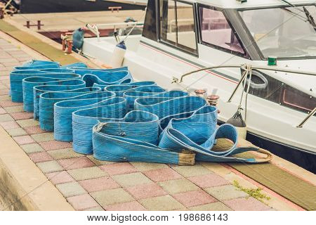 Sea Ropes On The Pier. Equipment For Tying Yachts Concept