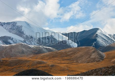 The view of the mountain range and valley in the Tien Shan. The mountainous landscape. Kyrgyzstan