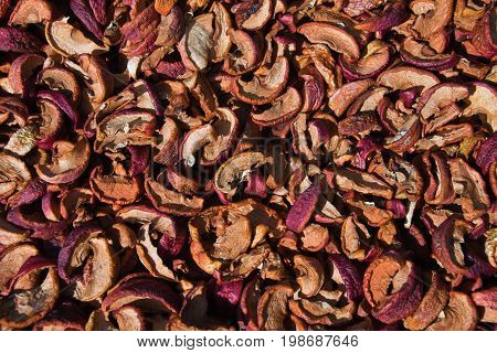 Dried sliced apples. Traditional drying of apples in the air and the sun in Kyrgyzstan. Background of dried fruit.