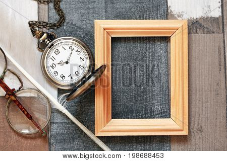 Vintage still life with old glasses and wooden frame