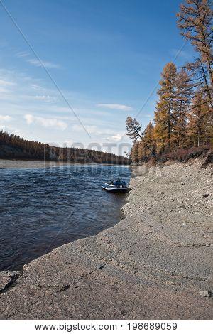 The boat to the shore of the Siberian taiga river in September. Moiyero river Evenkia Krasnoyarsk region Russia