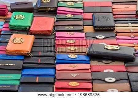 AVSALLAR TURKEY - JULY 01 2015: Purse of Michael Kors. Flea market in the village. Michael Kors is a New York City-based fashion designer of American sportswear.