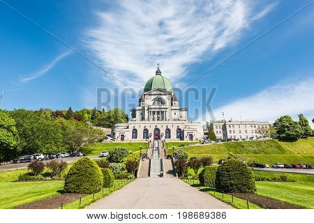 Montreal Canada - May 28 2017: St Joseph's Oratory on Mont Royal with woman praying on steps in Quebec region city