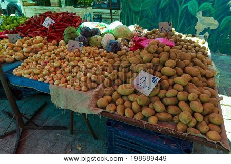 AVSALLAR TURKEY - JULY 01 2015: Sales of fresh vegetables on a traditional street market (bazaar).
