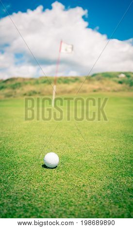 Golf ball on a green waiting to be putted