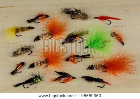 Reservoir trout fishing lures arranged on a wooden worktop