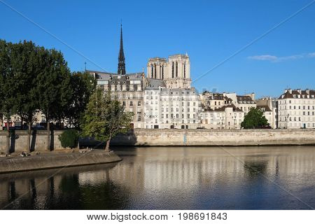 The houses in Saint-Louis Island and Notre Dame cathedral towers in the background, Paris, France.