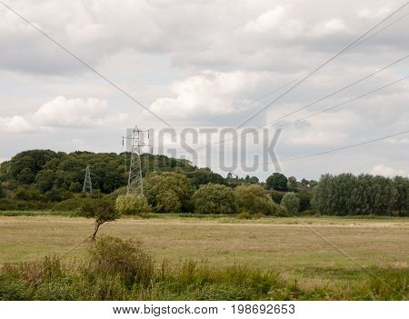 A Metal Pylon Outside In The Country With Wires Overhead