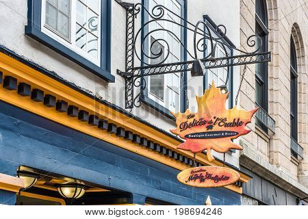 Quebec City Canada - May 29 2017: Closeup of sign for maple syrup merchandise and souvenirs called Les Delices de L'Erable on old town street