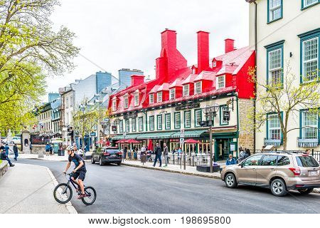 Quebec City Canada - May 29 2017: Old town Sainte Anne street with red restaurants by place d'arms park by Chateau Frontenac with people walking