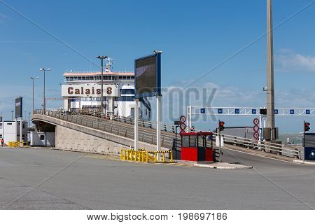 Ferry to England moored for embarking or disembarking at numbered harbor gate in Calais France