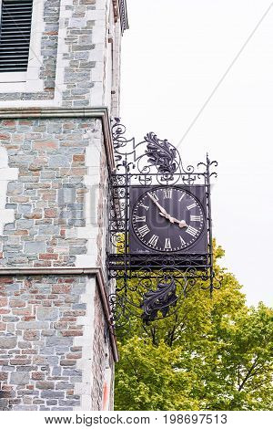 Quebec City Canada - May 29 2017: Saint Jean Baptiste area with closeup of clock time at Claire Martin library on sidewalk