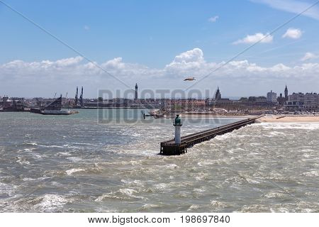 French harbor of Calais with breakwater and heavy storm