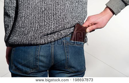 Pickpocket is trying to steal a wallet