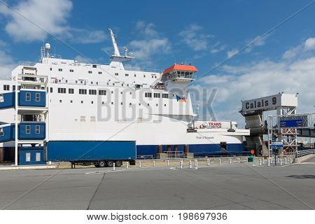 HARBOR CALAIS FRANCE - JUNE 07 2017: Ferry to England moored for embarking or disembarking at harbor gate in Calais France