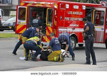 RESEDA, CALIFORNIA, USA - MAY 9: Firefighters help the victim of car accident on May 9, 2011 on Sherman Way in Reseda, California.