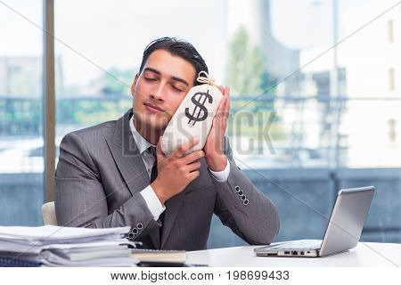 Businessman with money sack bag in office