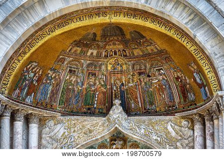 Mosaic of the portal of the Basilica di San Marco (Saint Mark`s Basilica) in Venice, Italy. Basilica di San Marco was built in the 12th century and is the main tourist attraction of Venice.