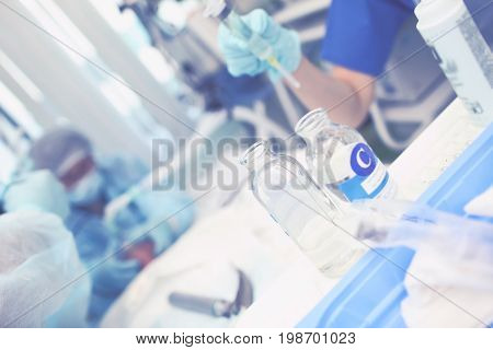 Medical assistant work during the urgent surgery.