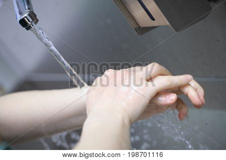 Professional hand washing before the surgery in hospital.