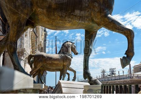 Ancient bronze horses of the Basilica di San Marco over the Piazza San Marco or St Mark`s Square in Venice, Italy. This is the main square of Venice.