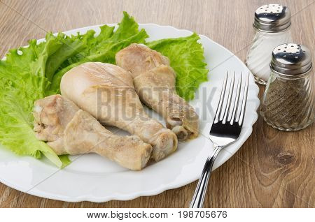 Fried Chicken Legs, Leaves Of Lettuce In Plate, Salt, Pepper