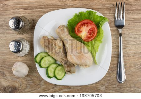 Fried Chicken Legs With Vegetables In Plate, Salt, Pepper