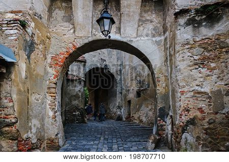 Ancient medieval stone archway in the fortress at Sighisoara town in Romania.