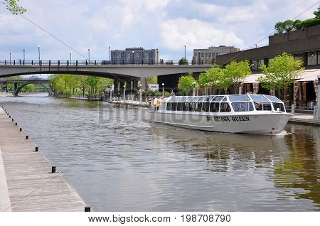 OTTAWA, CANADA - MAY 15, 2012: Ottawa Queen cruise ship on Rideau Canal in downtown Ottawa, Ontario, Canada. Rideau Canal was registered as a UNESCO World Heritage Site.