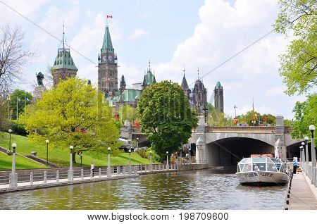 OTTAWA, CANADA - MAY 15, 2012: Canada Parliament Buildings and Rideau Canal, Ottawa, Ontario, Canada. Rideau Canal was registered as a UNESCO World Heritage Site.