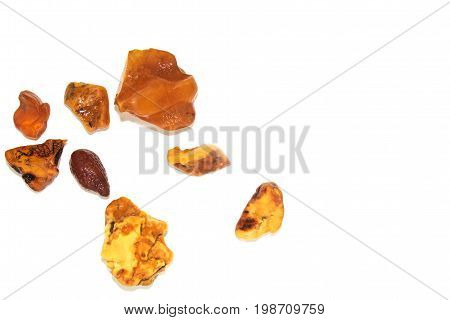 Eight Different Pieces Of Amber On A White Background.