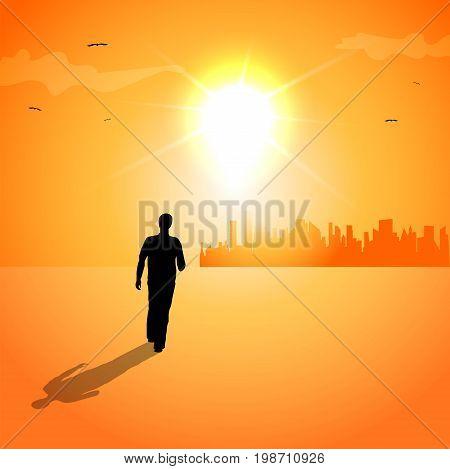Man walking at sunset towards the city