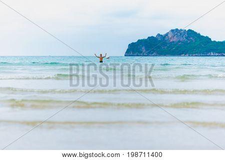 PRACHUAP KHIRI KHAN, THAILAND - MARCH 16, 2017: European tourist (unidentified) enjoys Ao Manao beach. Ao Manao is the main beach area of Prachuap Khiri Khan