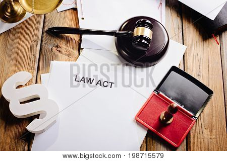 Law Act On Old Wooden Desk In Library