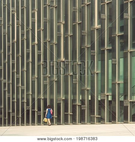 Seoul - July 2017: Students walking by glass wall of campus complex at Ewha Womans University.
