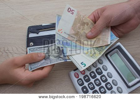 people exchanging money saving and finance concept - close up of male and female hands giving or exchanging money