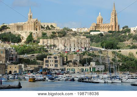 Harbour Mgarr with Church of Our Lady of Lourdes in Gozo, Malta