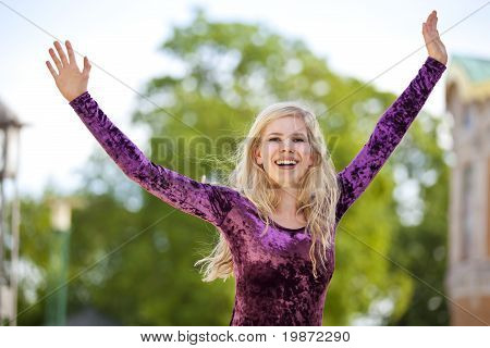 cheering blond fashion model