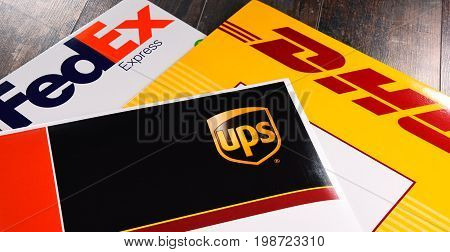 POZNAN POL - AUG 2 2017: Envelopes of 3 most popular courier services in the world: UPS FedEx and DHL