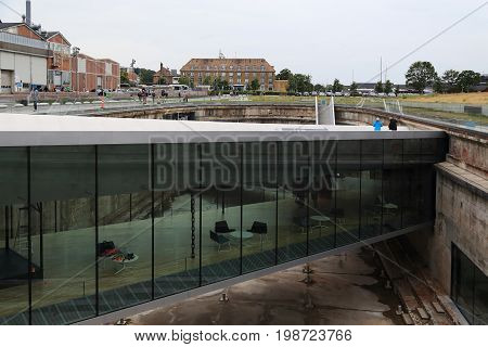 HELSINGOR, DENMARK - JUNE 30, 2016: This is one of the bridges of glass and steel connecting different parts of the dry dock which houses the Maritime Museum of Denmark.