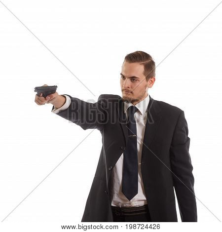 Man wearing a suit holding his handgun