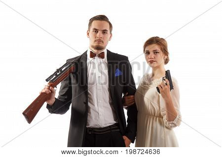 Man and a woman in formal clothes with guns