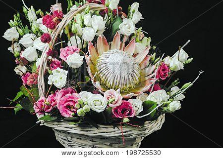 Basket Of Flowers On Dark