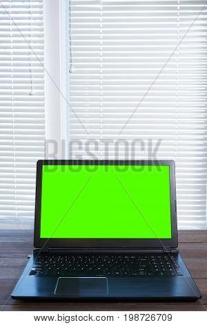 Laptop With Green Screen Vertical Shot