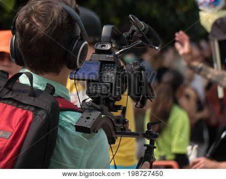 Professional cameraman television audio video equipment filming event